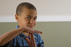 Multi Racial Boy Signaling a Time Out Royalty Free Stock Image