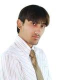Multi-racial businessman. Studio portrait of a multi-racial young businessman isolated on white background Stock Photos