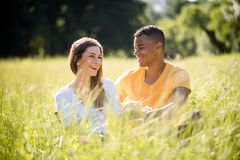 Multi racial couple dating in nature Stock Photography