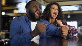 Multi-racial couple rooting for national team watching game, entertainment. Stock footage stock video footage