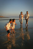 Multi-racial Family On Beach Stock Photo