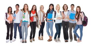 Multi racial of group of students. Young Multi Racial Of Group Of Students Standing Over White Background Stock Image