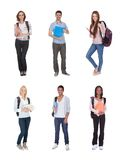 Multi racial of group of students. Young Multi Racial Of Group Of Students Standing Over White Background Royalty Free Stock Photos
