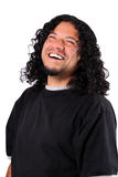 Multi-racial male. With bright white teeth smile and long curly hair on a white background royalty free stock photos