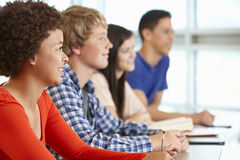 Multi racial teenage pupils in class Royalty Free Stock Photo