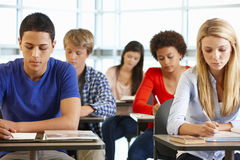 Multi racial teenage pupils in class stock images