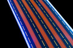 Multi racing lanes with LED light for kid toy car racing. Multi racing lanes or tracks with LED light for kid toy car racing isolated on black background Stock Image