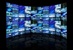 Multi screens showing business images Stock Photography