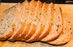 Multi-Seeded Loaf. Sliced on Chopping Board Stock Photography