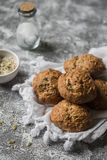 Multi seeds whole wheat rolls on a grey stone background. Healthy food Stock Image