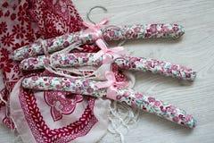 Multi silk Hangers. Multi luxury padded dress hangers Royalty Free Stock Photos