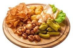 Multi Snack auf hölzernes Brett Archivbild Lizenzfreie Stockfotos