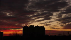 The multi-storey building against the background of a sunset stock footage