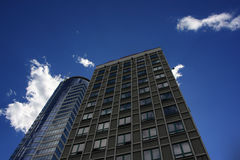 Multi-storey building. Modern multi-storey building against the sky and clouds stock photos