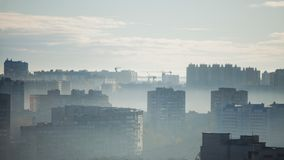 Multi-storey building. Morning panorama of the big city. High-rise buildings. In the fog royalty free stock photo
