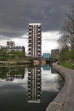 Multi-storey building on the Regent canal reflected in the water. Royalty Free Stock Images
