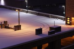 Multi storey car park with fresh snow and tire tracks Royalty Free Stock Image