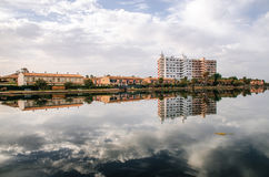 Multi-storey hotel is reflected in the Esperanza lake in Port d'Alcudia. Royalty Free Stock Image