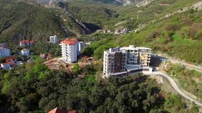 Multi-storey house in the mountains. Montenegrin architecture. P. Roperties in the mountains of Montenegro. Aerial Photo Property drone stock footage