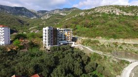 Multi-storey house in the mountains. Montenegrin architecture. P. Roperties in the mountains of Montenegro. Aerial Photo Property drone stock video