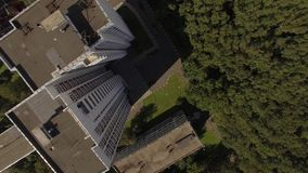 Multi-storey houses near the forest. Motor road. The view from the height of bird flight stock video footage