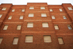 Multi-storey residential building of red brick Royalty Free Stock Photos