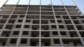 Multi-storey residential building under construction. Camera moving up. Multi-storey residential building under construction. Camera moving up stock video