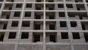 Multi-storey residential building under construction. Front view. Multi-storey residential building under construction. Front view stock footage