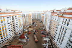 Multi-storey residential buildings under construction, trucks Stock Photography