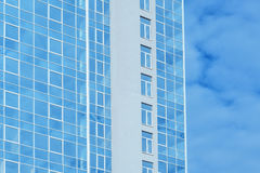 Multi-story glass office building against the sky Stock Image
