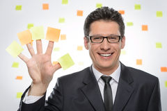 Multi-tasking businessman. Portrait of cheerful businessman show Stock Image