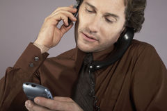 Multi Tasking Businessman Using Phones Royalty Free Stock Images