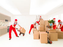 Multi tasking delivery man Stock Photos