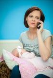 Multi-tasking moeder Stock Fotografie