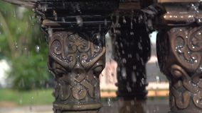 Multi-tiered Fountain in the Park. Multi-tiered fountain with splashing water closeup shot in the park on a warm sunny day stock footage