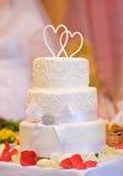 Multi-tiered white wedding cake Stock Photo