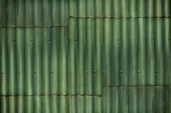 Multi-tone green corrugated wall with seams and bolts add intere Stock Images