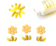 Multi Vitamins for growing up. A concept still life photograph image of some assorted vitamin pills and capsules making a happy picture of healthily growing Stock Images