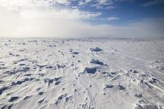 Multi year ice floe. Vast frozen ocean at Antarctica taken onboard a research icebreaker Stock Photo