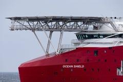 Multi Zweck der australischen Grenzkraft weg vom Uferschiff Ozean-Schild in Jervis Bay stockfotografie