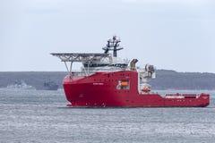 Multi Zweck der australischen Grenzkraft weg vom Uferschiff Ozean-Schild in Jervis Bay lizenzfreies stockfoto