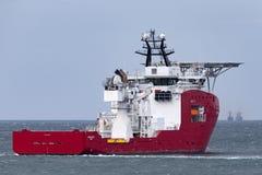 Multi Zweck der australischen Grenzkraft weg vom Uferschiff Ozean-Schild in Jervis Bay lizenzfreie stockfotografie