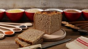 Multicereal and multigrain bread with the various ingredients around stock video