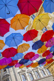 Multiclored moving blurred umbrellas background Stock Photos