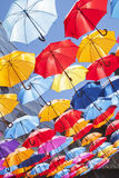 Multiclored moving blurred umbrellas background Stock Images