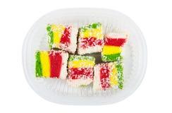 Multicolor турецкое наслаждение в коробке прозрачной пластмассы Стоковое фото RF