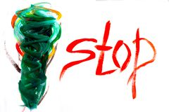 Multicolor abstract drawing and word `Stop` are painted with brush and gouache royalty free stock photography