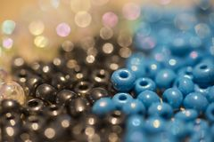Multicolor Beads in three colors. Multicolored beads with shallow depth of field Stock Photo