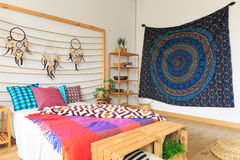 Multicolor bedroom with ethnic design Royalty Free Stock Images