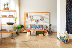 Bedroom in ethnic designed apartment Stock Images